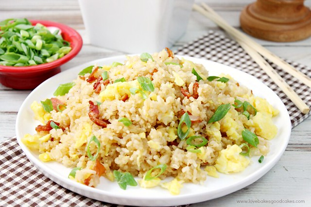 Bacon & Egg Breakfast Fried Rice on a plate with chop sticks.