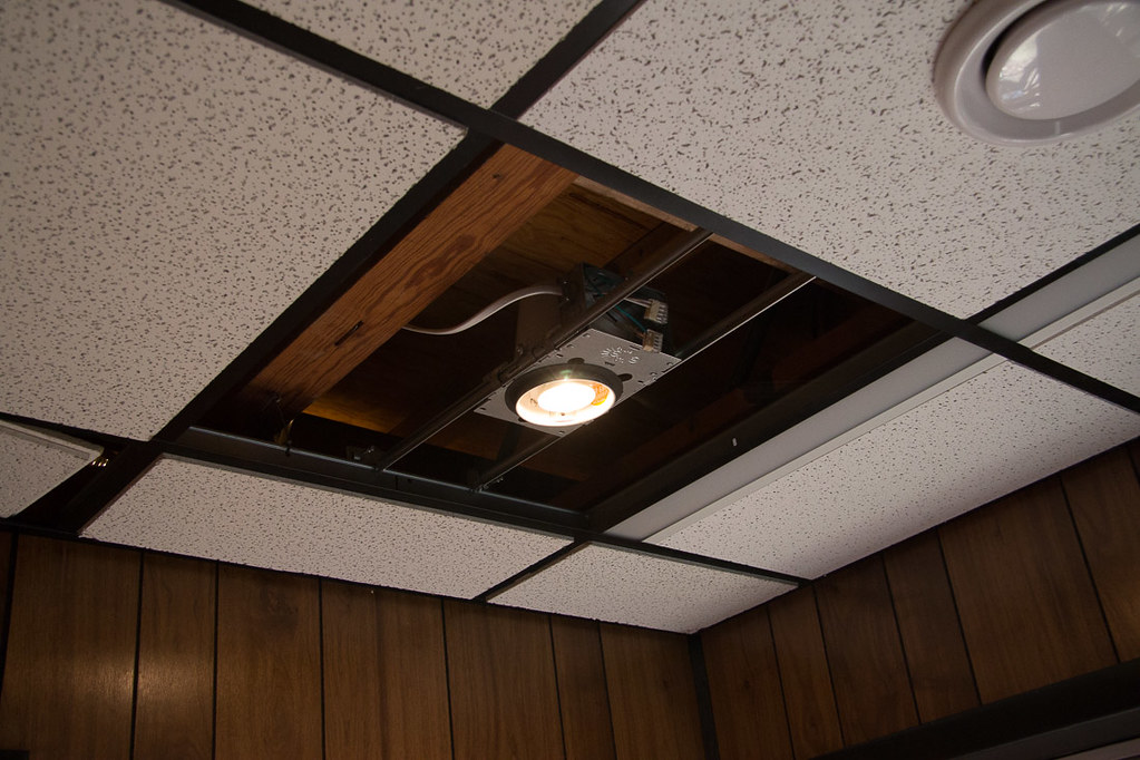 Diy recessed lighting installation in a drop ceiling ceiling tiles installing lightbulb during recessed lighting installation aloadofball Choice Image