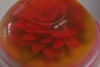 This flower was made by a friend for Denise out of Jello. Each petal is cut out of a sheet of Jello to assemble the flower before encasing them with more Jello.