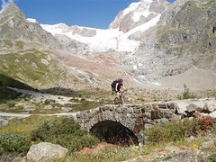 Helen Cycling into Italy from our descnt of the Col de la Seigne 2516m Image