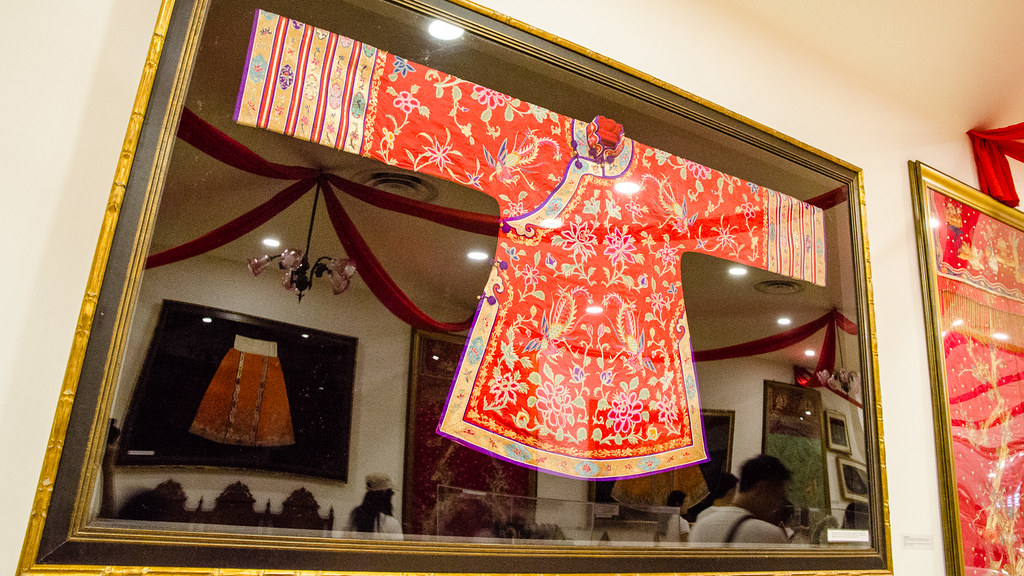 Baba and Nyonya traditional cloth. Looks like cheongsam.