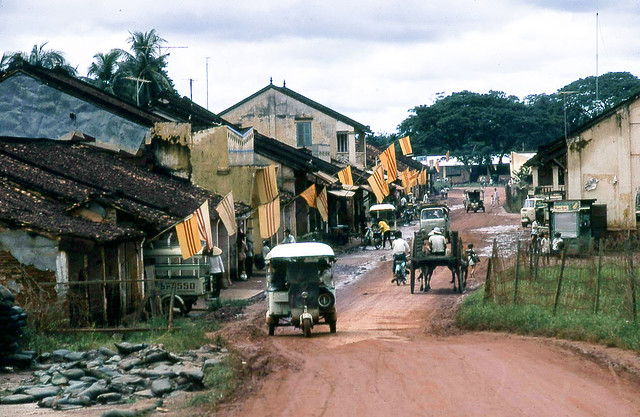 A village. Six Lambros, two motorbikes, and an oxcart. No cars.