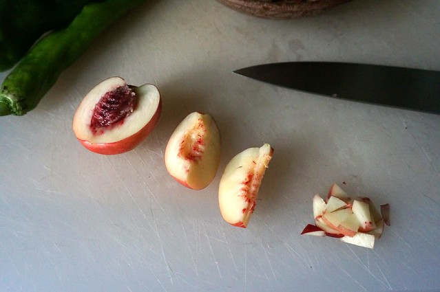 White nectarines being deconstructed: halved, quarter, slivered, and chopped