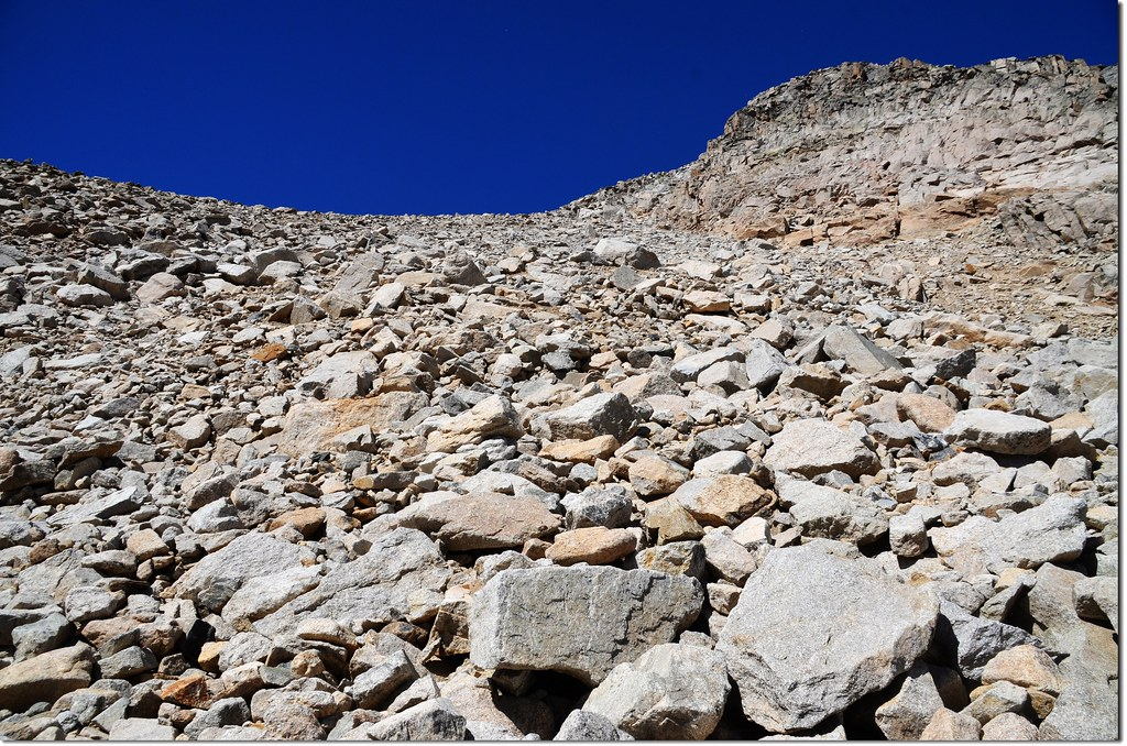 The route scales a steep wall in the southwest corner of the valley to reach the saddle beneath Mt Toll 2