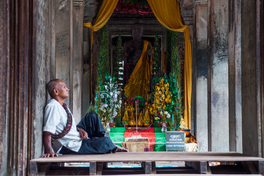 Angkor Wat Temple  shrine with man in Siem Reap, Cambodia