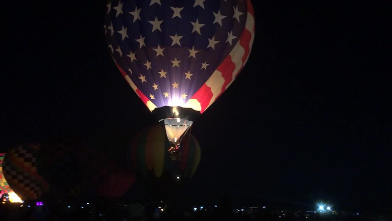 American flag balloon glowing.