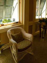 Wicker rocking chair by window