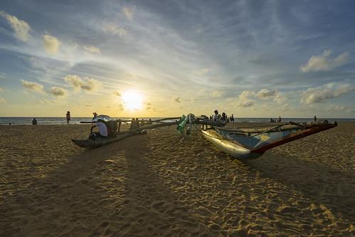 light sunset sea people sun beach water landscape boat seaside sand asia dusk sony wideangle bluesky srilanka westernprovince negombo traval sonyalpha sonyzeiss sonya7 sel1635z sony1635mmvariotessartfef4zaoss