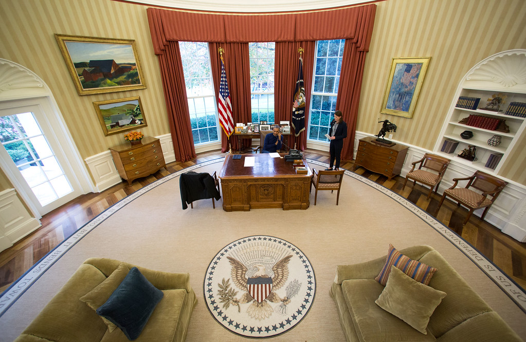 <p>President Barack Obama makes Thanksgiving Day phone calls from the Oval Office to U.S. troops stationed around the world, Nov. 24, 2016. The President's Coast Guard military aide, LCDR Ginny Nadolny is at right.<br /> (Official White House Photo by Pete Souza)<br /> <br /> This official White House photograph is being made available only for publication by news organizations and/or for personal use printing by the subject(s) of the photograph. The photograph may not be manipulated in any way and may not be used in commercial or political materials, advertisements, emails, products, promotions that in any way suggests approval or endorsement of the President, the First Family, or the White House.</p>
