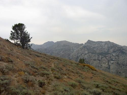 mountains landscape smoke trail