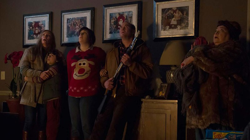 Toni Collette, Emjay Anthony, Allison Tolman, David Koechner, fake baby and Conchata Ferrell wait to confront the holiday monsters in KRAMPUS.
