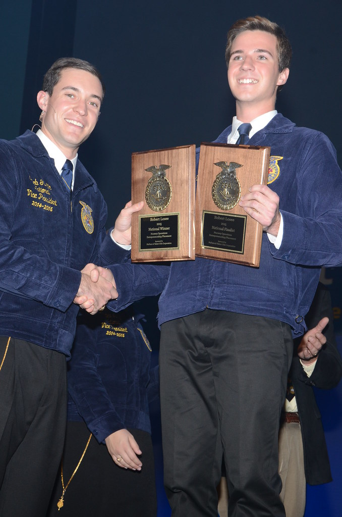 Robert Losee of Woodsbridge (right) is congratulated by National FFA Officer Caleb Gustin on being named the national winner in the Nursery Operations Proficiency award area at the National FFA Convention, held October 28-31 in Louisville, Kentucky. Proficiency awards recognize FFA members who excelled as agricultural entrepreneurs, employees or volunteers while they gained hands-on career experience. Losee is majoring in horticulture and plans to own his own greenhouse nursery business.