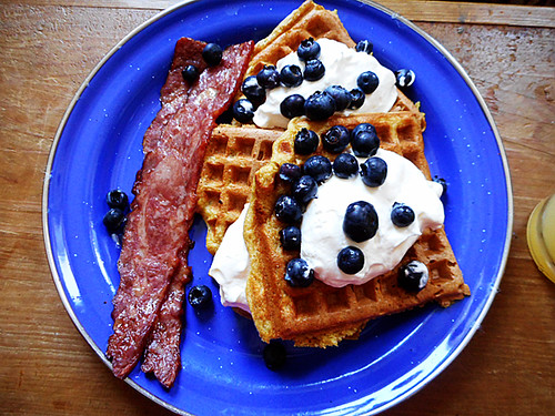 orangenwaffles with blueberries and duck bacon