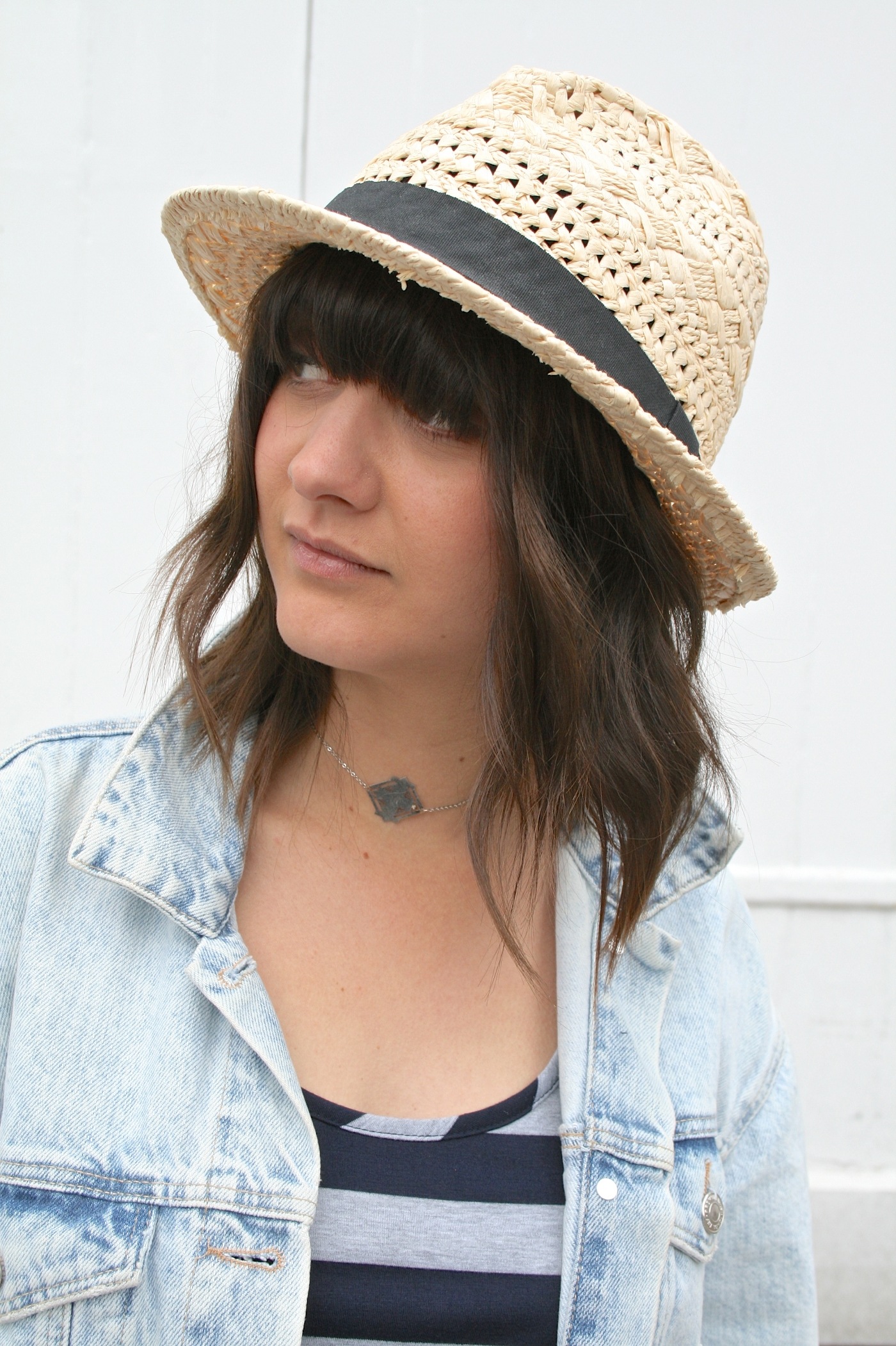 straw hat and chocker necklace
