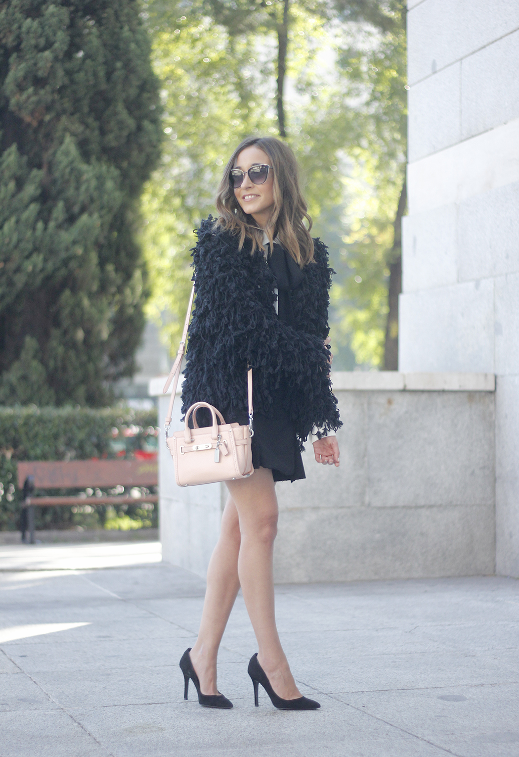 black jacket shirt with black bow coach pink bag heels outfit16