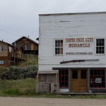 South Pass City, WY is basically the remains of an old mining town, with about half converted into a state historic district and about half being contemporary residences.  I'm not usually one for enjoying reconstructed history, but they've done a very good job and there is some quite surprising history (see following pictures).  See also:  wyoparks.state.wy.us/Site/SiteInfo.aspx?siteID=30