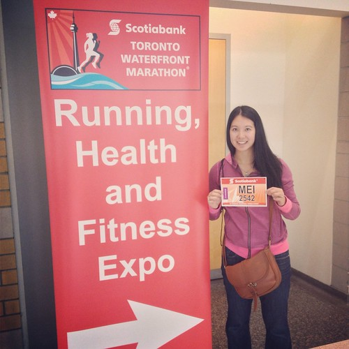Mei at the expo with her marathon race bib