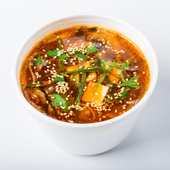 Hot food delivery - miso soup isolated