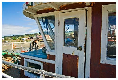 ship boat seaside marina port chile islagrandedechiloe quellon island canon