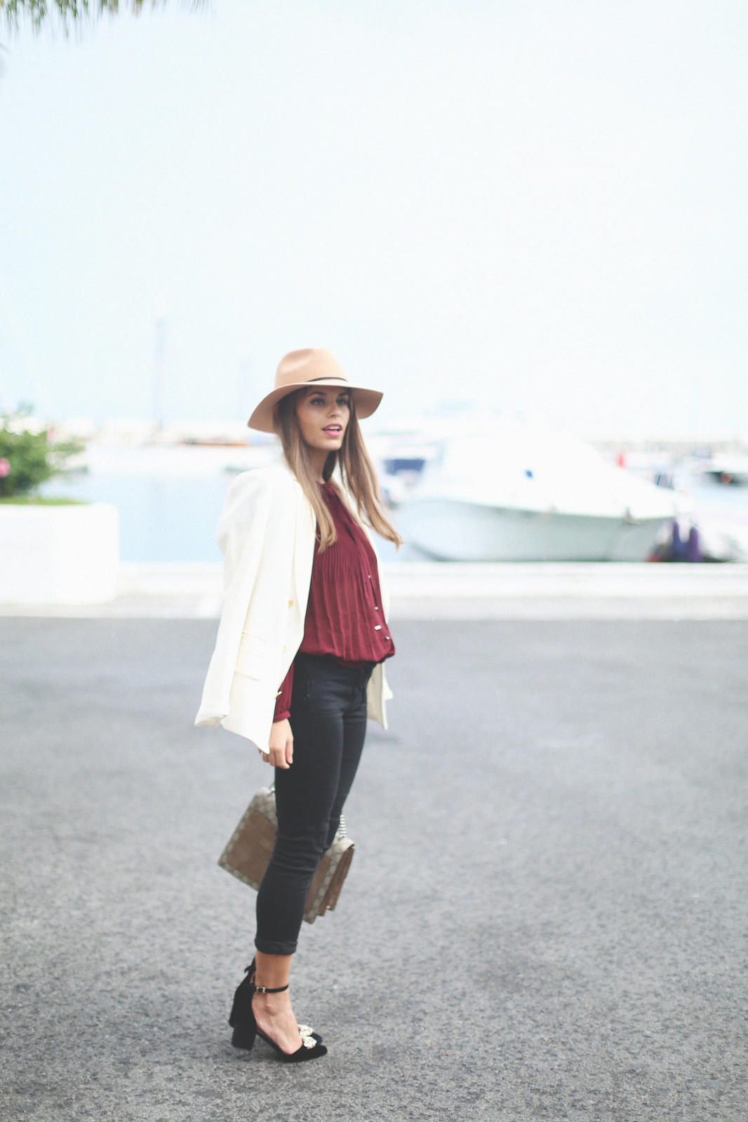 7. jessie chanes burgundy blouse cropped black jeans gucci bag