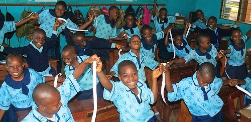 Students of St Louis Nursery and Primary School Akure waving white ribbons during the International Day of Peace celebrations