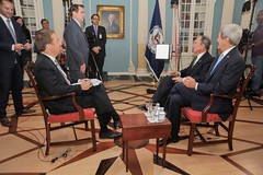 U.S. Secretary of State John Kerry, former New York City Mayor Michael Bloomberg, and Chuck Todd, host of NBC's 'Meet the Press, chat with State Department Spokesperson John Kirby before an interview about climate change in the Treaty Room of the U.S. Department of State on October 8, 2015. [State Department Photo/Public Domain]