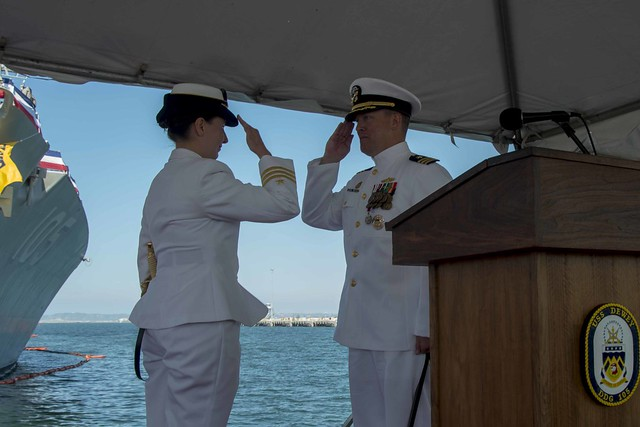 SAN DIEGO - Cmdr. Abigail A. Hutchins, left, salutes Cmdr. Mikael A. Rockstad relieving him as commanding officer of USS Dewey (DDG 105) during a change of command ceremony at Naval Base San Diego.