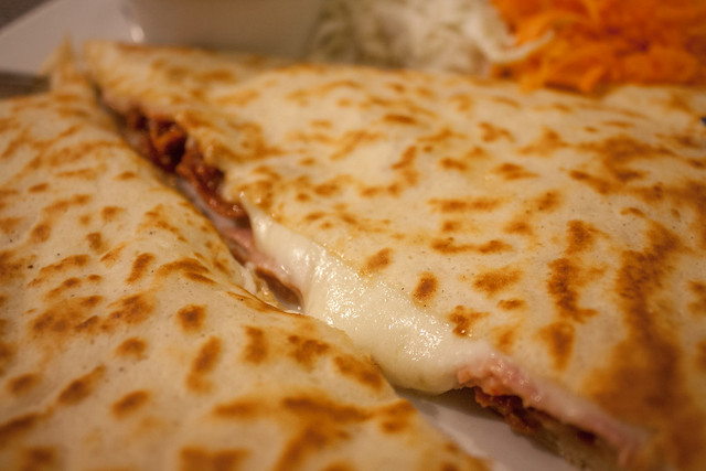 Pancake with dried tomatoes, mozzarella, ham & bechamel sauce at Manekin, Poznań