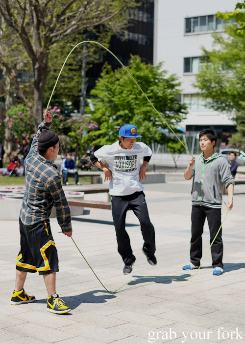 Big kids skipping at Odori Park in Sapporo