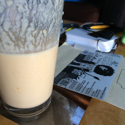 A smoothie, half consumed, on my coffee table. Half-full? Half-empty? I don't know. It's fully delicious, though.