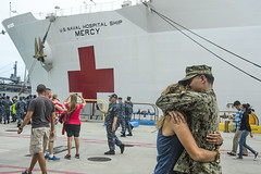 A Sailor greets his friend after departing the hospital ship USNS Mercy (T-AH 19) in Guam. (U.S. Navy/MC2 Mark El-Rayes)