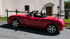 automobile(1.0), automotive exterior(1.0), vehicle(1.0), fiat barchetta(1.0), land vehicle(1.0), luxury vehicle(1.0), convertible(1.0), sports car(1.0),