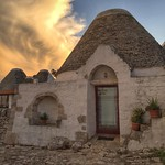 Sunset on our trulli farm stay in the valley outside the town of Martina Franca, Italy. A trullo is the traditional Puglian (Apulian) stone hut with a cone roof, dating as far back as the 14th century. Although many started out as store houses, over tim