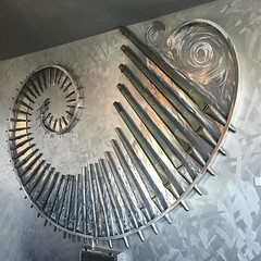 Spiral artwork made of pipe organ pieces at Mellow Mushroom in Rock Hill.