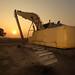 excavator at sunrise by John √