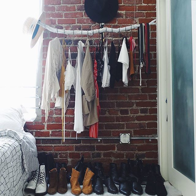 Hanging branch clothing rack, exposed brick, DTLA loft