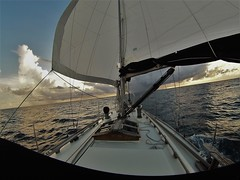 Sailing wing and wing into the stormy sunset, between New Bight and Arthur's Town, Cat Island