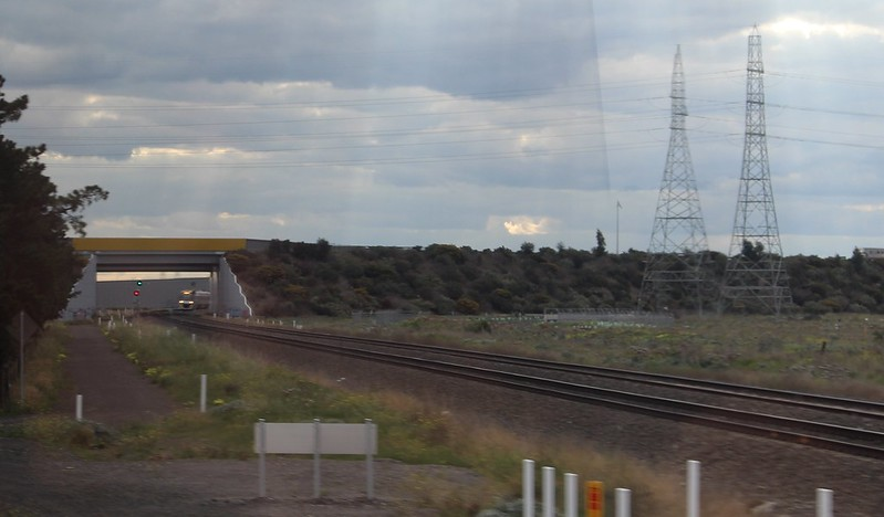 Train from Ballarat, seen from the train from Geelong, both approaching Deer Park