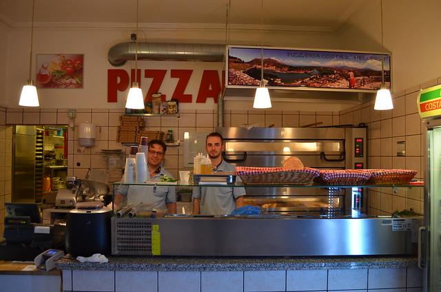 Copenhagen Costa D'Hellerup pizzeria owner behind the counter with employee