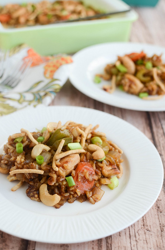 Cashew Chicken Casserole - your favorite takeout as an easy casserole! Chicken, rice, and veggies in a delicious savory sauce. And topped with crunchy chow mein noodles and cashews!