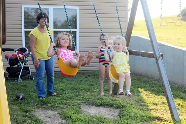 Devyn and Harper swinging