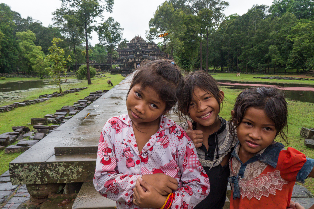 Baphuon Temple young girls play outside at Angkor Thom in Siem Reap, Cambodia-2
