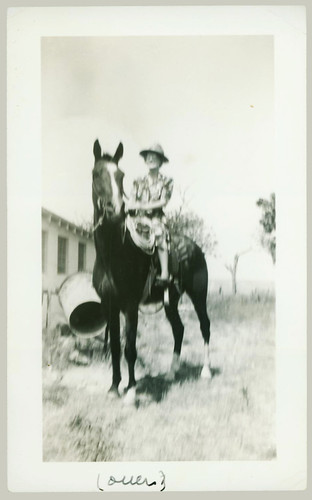 Woman on a horse.