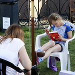 Girl reading in the sun | Enjoying a good book in the sun at the Book Festival © Helen Jones
