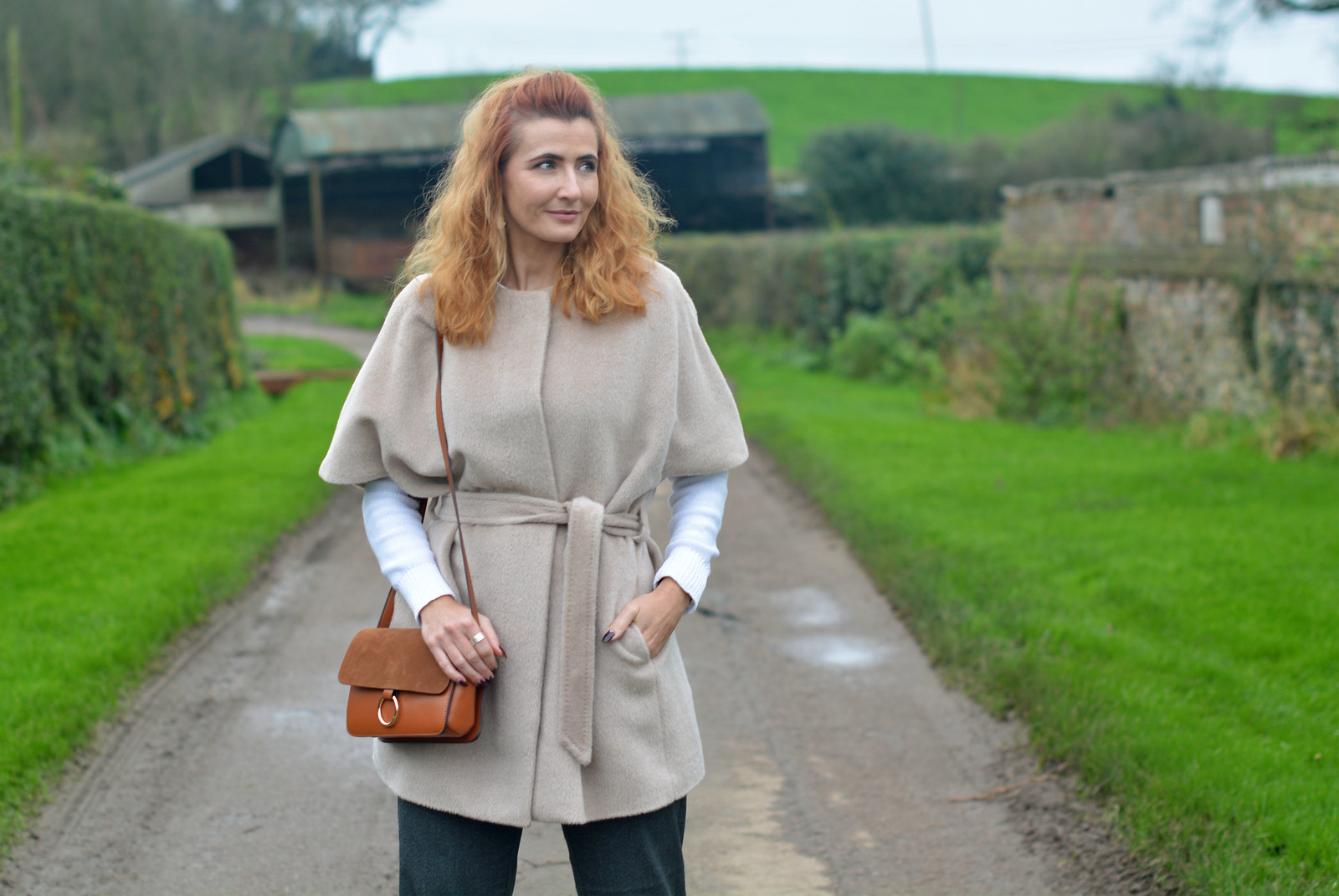 Jaeger alpaca coat | Winter neutrals with tan cross body bag