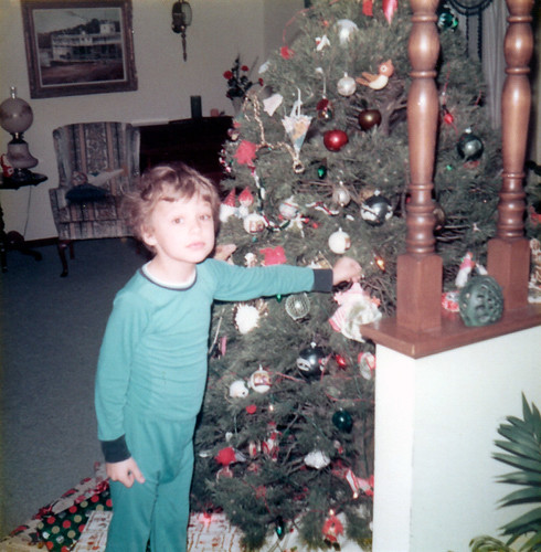 Me with an ornament on our tree.