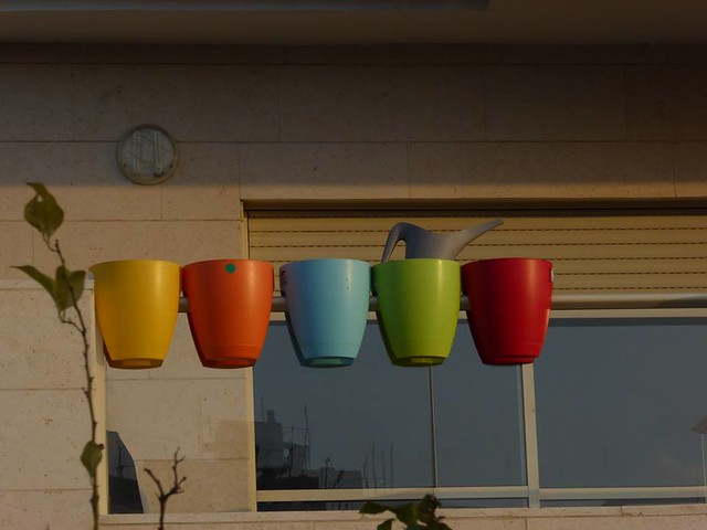Colourful flowerpots and watering can