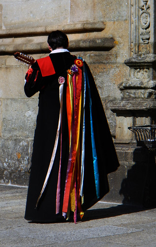 A Musician in a Traditional Cloak in Santiago de Compostela, Spain