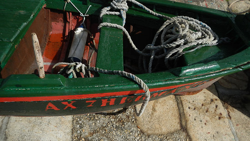 A red and green boat in dry dock in a town on the west coast of Galicia, Spain