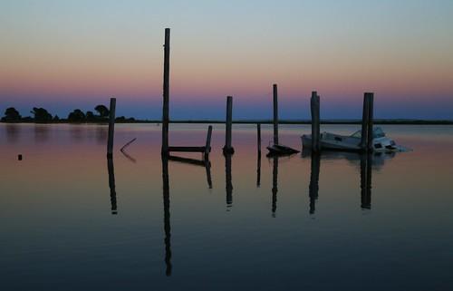 blue light orange reflection nature water sunrise boats coast fishing dock florida pastel fl pilings silouhette apalachicola theforgottencoast canon24105 sunkenboats canon6d apalachicolafl
